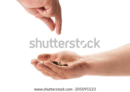 Dirty beggar hand receiving coins from another person - stock photo