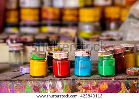 dirty bottle of color on wooden table. - stock photo