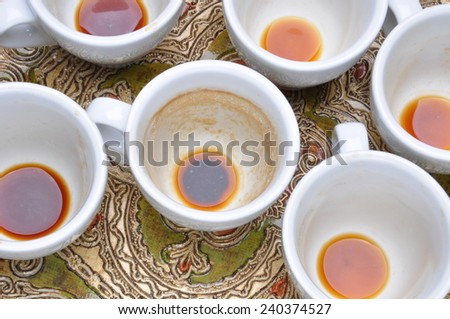 Dirty cups after coffee on the table - stock photo