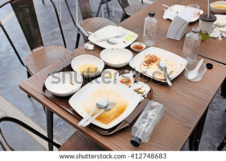 dirty dishes on a table in a restaurant - stock photo