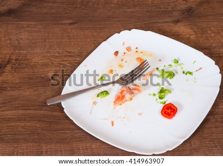 dirty dishes on wooden table - stock photo