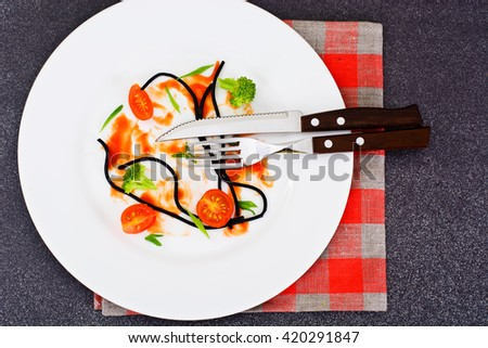 Dirty Dishes. Remains Smeared Sauce and Spaghetti Studio Photo - stock photo