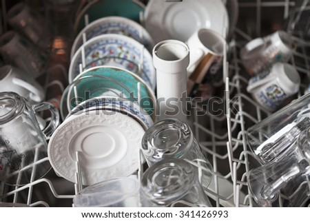 dirty dishwasher - stock photo