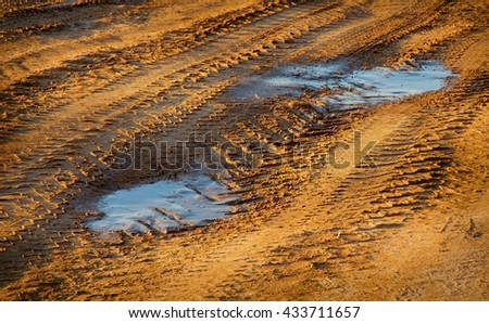 dirty earth road with puddles - stock photo