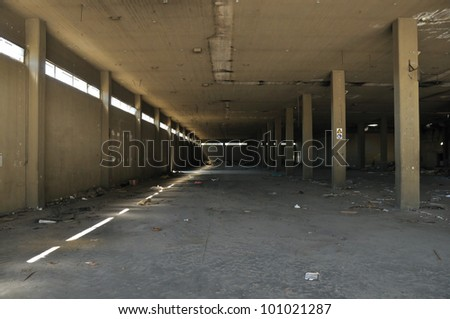 Dirty floor concrete wall and ceiling in abandoned factory. Industrial architecture. - stock photo