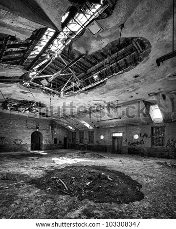 Dirty floor of an abandoned building from the Manteno State Mental Hospital in Manteno, Illinois - stock photo