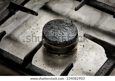 Dirty gas burner closeup - stock photo