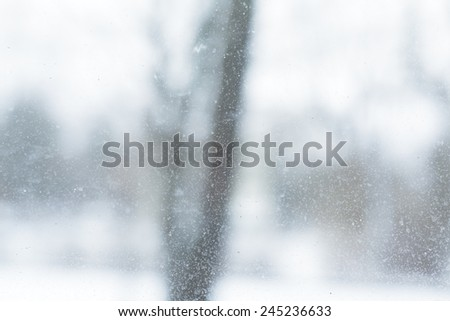 dirty glass with drops, cold winter outside blured - stock photo