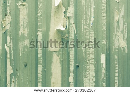 Dirty grunge wall with torn advertisement poster  - stock photo