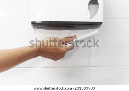 dirty hand picking a toilet paper - stock photo