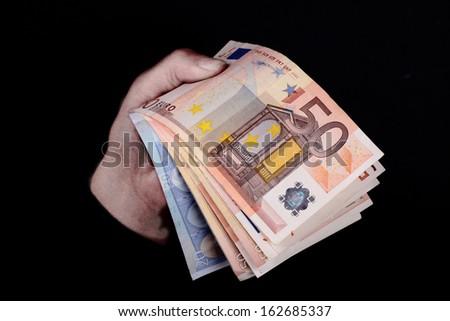 dirty hands grabbing Euro banknotes - stock photo