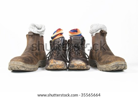 Dirty hiking boots and socks - stock photo