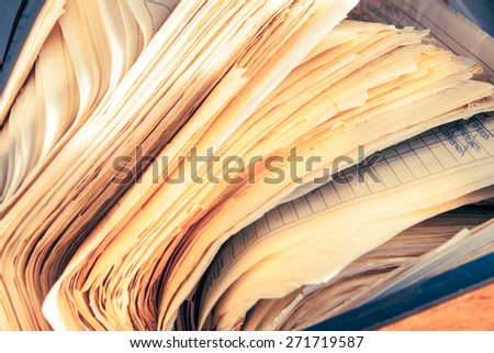 Dirty messy paper documents as background closeup - stock photo