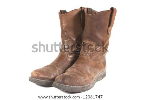 Dirty Old Boots - stock photo