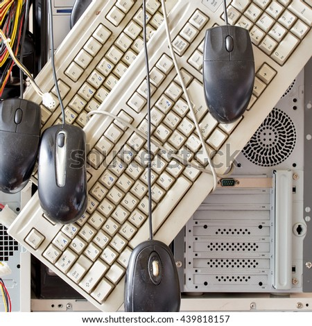 dirty old computers, keyboard, mouse for electronic recycling - stock photo