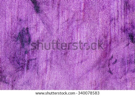 Dirty old fabric as a grunge background texture - stock photo