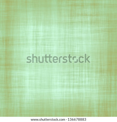 Dirty old green and brown fabric texture suitable for a background or overlay - stock photo