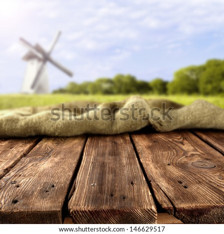 dirty old table and background of mill  - stock photo