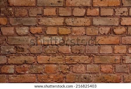 Dirty orange grungy brick wall background texture - stock photo