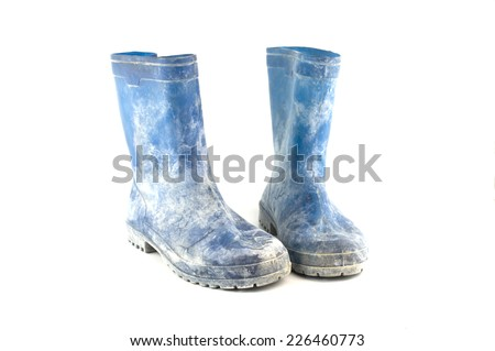 dirty rubber boots isolated on white background - stock photo