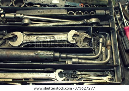 Dirty set of hand tools on a vintage background.  Tools and wrench - stock photo