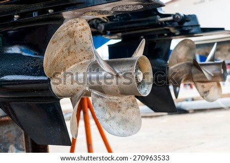 Dirty ship propeller waiting for clean up at the shipyard - stock photo