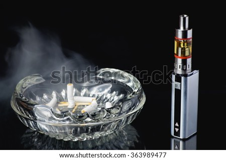Dirty, smelly ashtray and adjustable electronic cigarette, Non carcinogenic alternative for smoking - stock photo