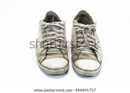 dirty sneakers isolated on a white background - stock photo