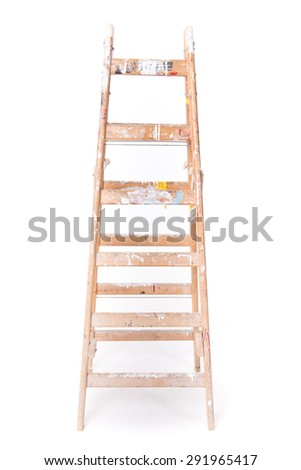 Dirty step ladder with paint spillings isolated on a white background - stock photo