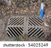 Dirty Storm Drain with Sign - stock photo