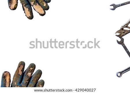 Dirty used groves and tools with copy space isolated background - stock photo