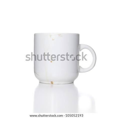 dirty white cup on white background - stock photo