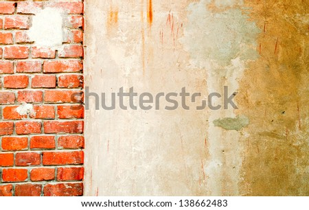 Dirty white wall with a piece of brick wall - stock photo