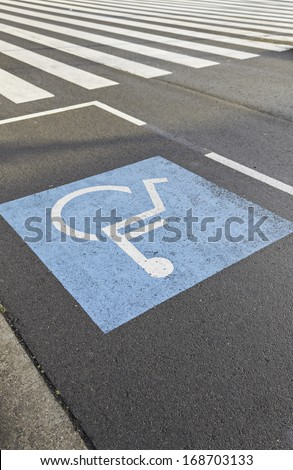Disability parking in urban road accessibility - stock photo