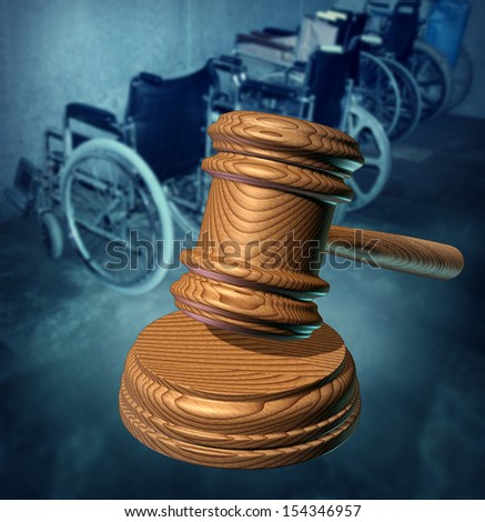 Disability Rights and fighting in a court of law for equal opportunity to citizens that are handicapped or physicality challenged to access services as a group of wheelchairs and a wooden judge gavel. - stock photo