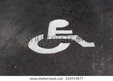 Disability Sign on the parking lot. - stock photo