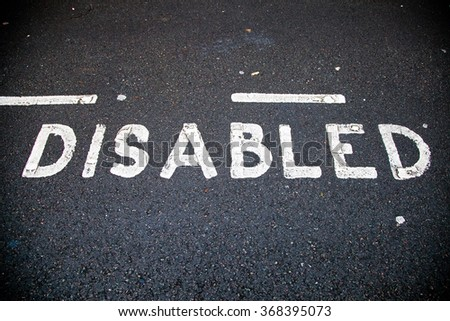 Disable parking road sign marking on tarmac - stock photo
