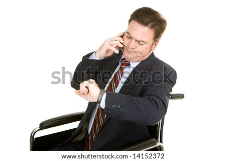 Disabled businessman looking at his watch while having a long boring phone conversation.  Isolated on white. - stock photo