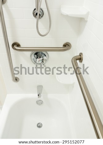 Disabled handicapped shower bathtub with grab bars - stock photo