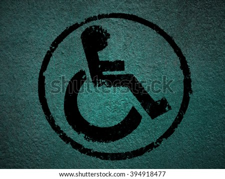 disabled icon sign, blue old fabric background. - stock photo