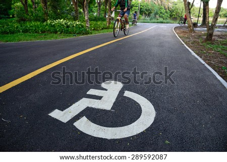 disabled icon sign on road - stock photo