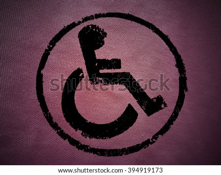 disabled icon sign, pink old fabric background. - stock photo