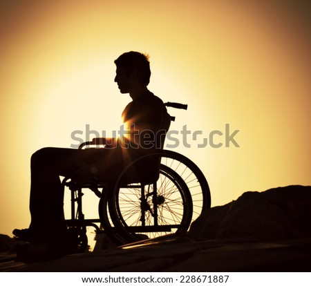 Disabled Man Silhouette - stock photo