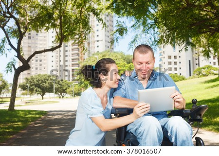 Disabled man with digital tablet  - stock photo