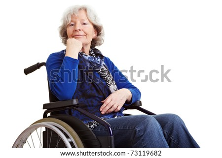 Disabled old senior woman sitting in a wheelchair - stock photo