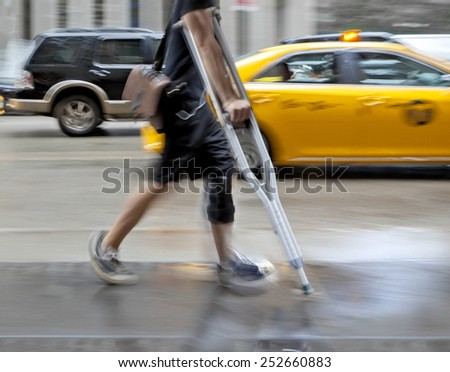 disabled on a city street - stock photo