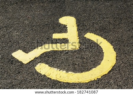 Disabled parking only sign with a wheel chair symbol. - stock photo