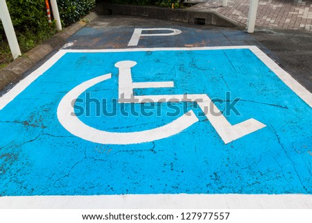 Disabled parking permit sign painted on car parking - stock photo