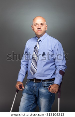 disabled person in studio is on crutches - stock photo