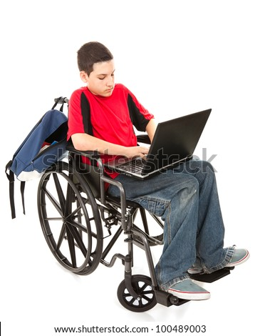 Disabled teen boy using a laptop computer.  Full body isolated on white. - stock photo